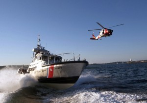 050826-C-2023P-796 Boston (Aug. 26, 2005) - Two Massachusetts-based U.S. Coast Guard assets, a 47-foot motor lifeboat from Coast Guard Station Gloucester and a HH-60 Jayhawk helicopter from Air Station Cape Cod, transit-out of the Gloucester Harbor during a training exercise. U.S. Coast Guard photo by Public Affairs Specialist 3rd Class Luke Pinneo (RELEASED)